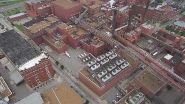 AERIAL MS View of factory in city / St Louis, Missouri, United States