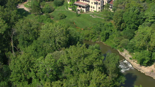 ms aerial view of  fair lane estate main house and powerhouse along rouge river / dearborn, michigan, united states - dearborn michigan stock videos and b-roll footage