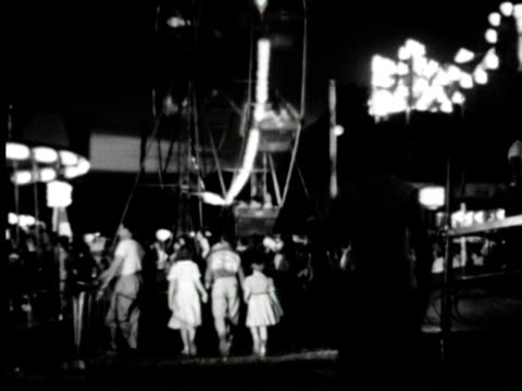 B/W TU View of fair people enjoying and fire work at end of fair, New York / AUDIO