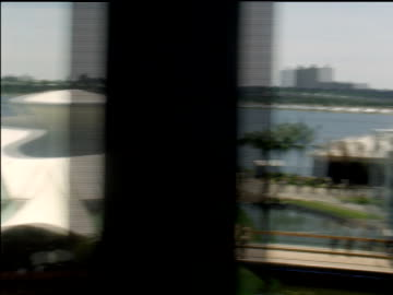 view of fairgrounds from monorail as it travels around world's fair. - new york world's fair stock videos & royalty-free footage