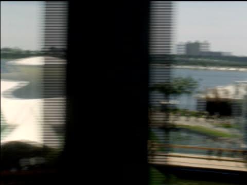 vidéos et rushes de view of fairgrounds from monorail as it travels around world's fair. - exposition universelle de new york