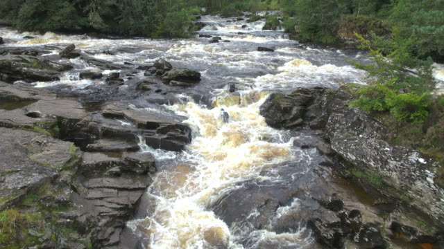 ms view of falls of killin and river dochart at trossachs / killin, stirling, scotland - スコットランド スターリング点の映像素材/bロール