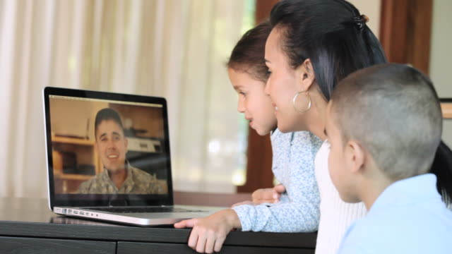 ms cu view of family talking with soldier on video call / richmond, richmond, united states - using laptop stock videos & royalty-free footage