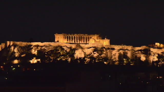ws view of famous acropolis and parthenon lit at twilight greek ruins at night / athens, greece - acropolis athens stock videos & royalty-free footage