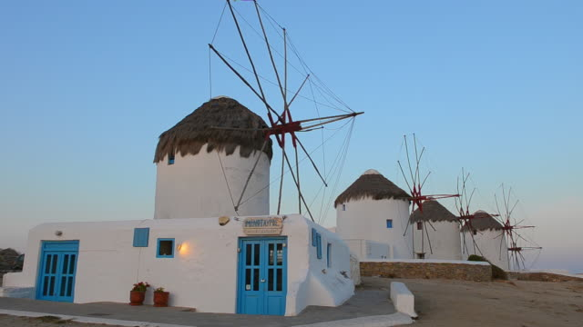 ws la view of famous five old 14th century windmills of white at sunrise / mykonos, greece - mykonos stock videos & royalty-free footage