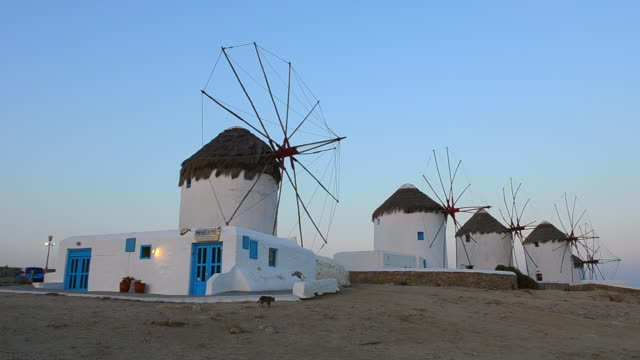 WS PAN View of famous five old 14th Century Windmills of white at sunrise / Mykonos, Greece