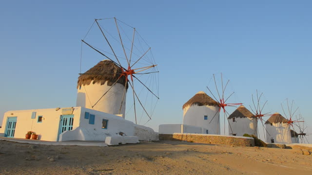 ws la view of famous five old 14th century windmills of white at sunset / mykonos, greece - mykonos stock videos & royalty-free footage