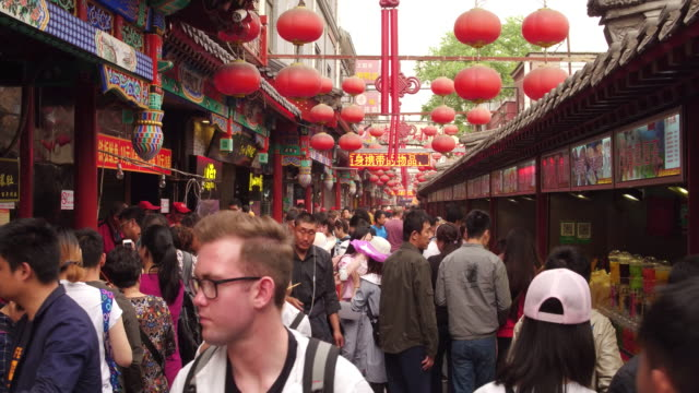 A view of famous Wangfujing Snack Street on May 4 2017 in Beijing China Wangfujing is a main business street for tourism next to the Tiananmen Square
