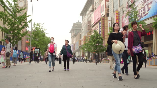 A view of famous Wangfujing Street on May 4 2017 in Beijing China Wangfujing Street is a famous shopping street which near famous Tiananmen Square