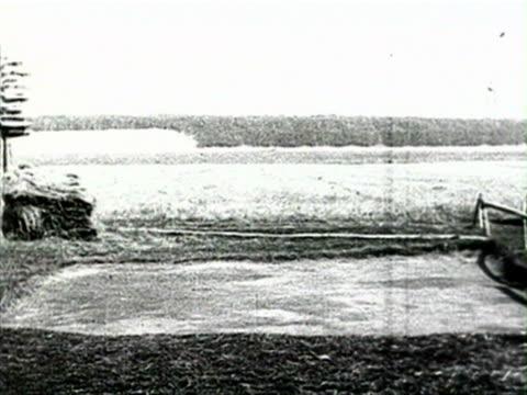 view of farm and man leading child on horse audio/ russia - 1925年点の映像素材/bロール