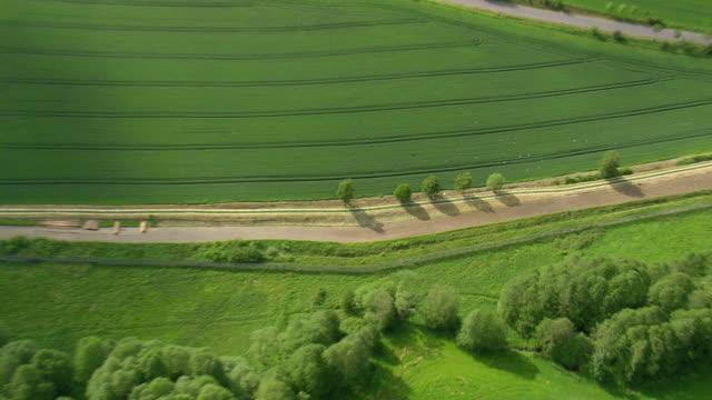 ws aerial zi view of farm field and fence at modlareuth / germany - ländliche straße stock-videos und b-roll-filmmaterial