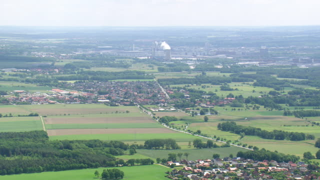 ws aerial view of farm field, houses and volkswagen factory at wolfsburg with cloud / germany - wolfsburg lower saxony stock videos and b-roll footage
