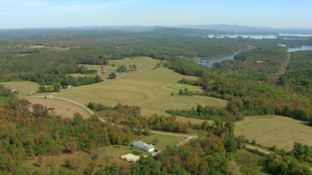 stockvideo's en b-roll-footage met ws aerial view of farm landscape in cherokee county / alabama, united states - alabama
