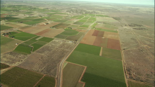 ws pan aerial view of farmland and farmhouse in outback / melbourne, victoria, australia - victoria australia stock videos & royalty-free footage