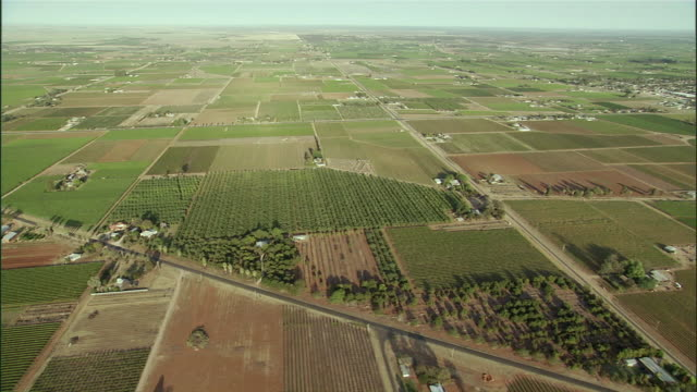 ws pan aerial view of farmland and farmhouse in outback / melbourne, victoria, australia - farm stock videos & royalty-free footage