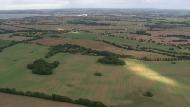 WS AERIAL View of farmland and windmills near port of Wismar / Germany