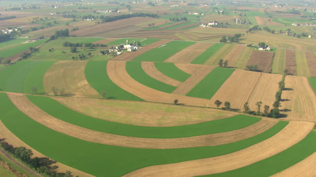 WS AERIAL View of farmland in different colors in Amish Country / Pennsylvania, United States