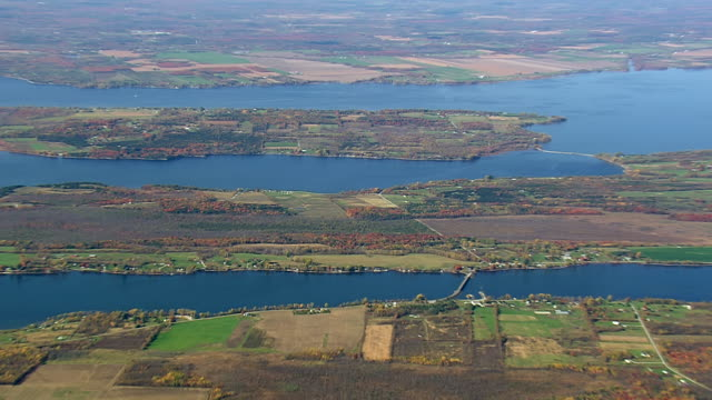 ws aerial pan zi view of farmland on island in lake champlain / vermont, united states - vermont stock videos & royalty-free footage