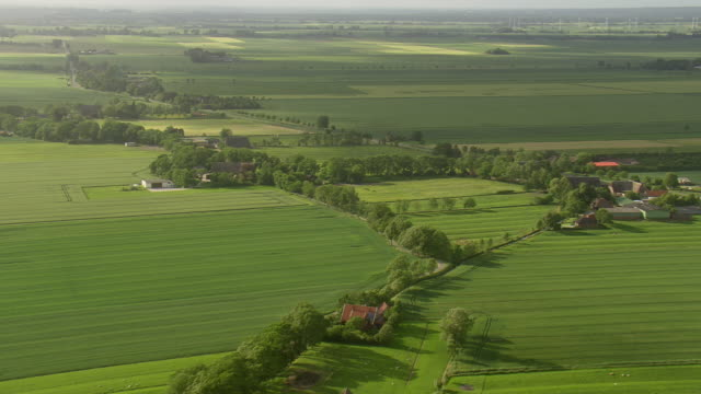 ws aerial view of farmland, trees and houses / germany - farmhouse stock videos & royalty-free footage