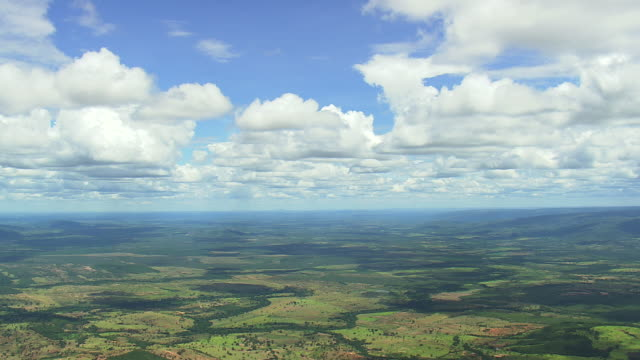 ws aerial view of farmland with clouds/ minas gerais, brazil - minas stock videos and b-roll footage
