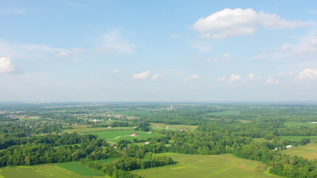 WS AERIAL POV View of farmland with lush area / Morgan County, Indiana, United States
