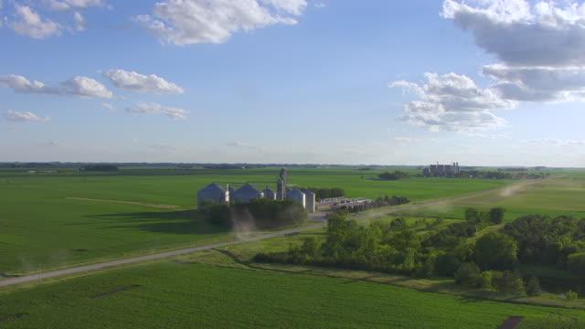 WS AERIAL POV View of farmland with Silos / Hardin County, Iowa, United States