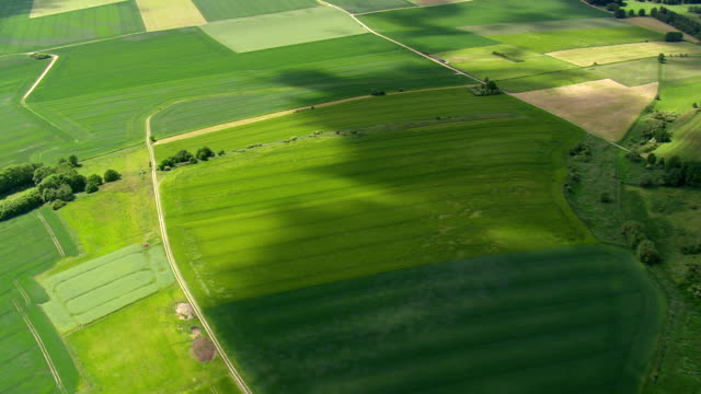 WS AERIAL View of farmland with small towns and clouds shadow moving on farm field / Germany