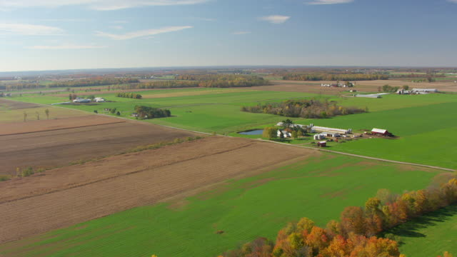WS AERIAL View of farms and fields under big sky in Ashland County / Ohio, United States
