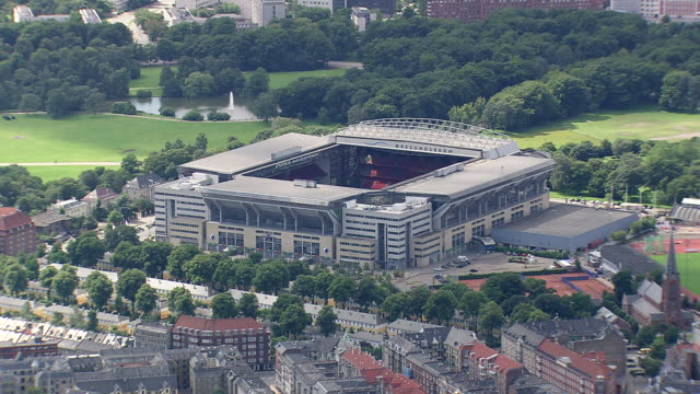ws aerial pan view of fc copenhagen stadium / copenhagen, denmark - copenhagen stock videos & royalty-free footage