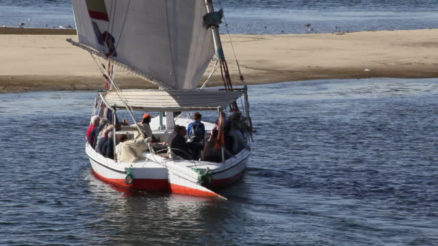 MS TS View of Felucca moving away filled with tourists / Aswan, Egypt