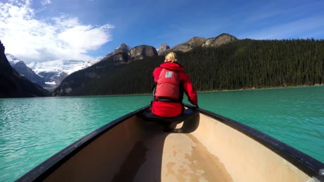 View of female Kayaking Lake Louise Alberta Canada