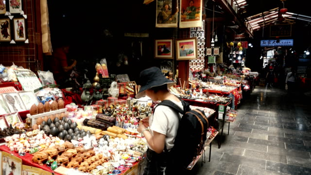 view of female tourists visiting the traditional market,xi'an,china. - shopping bag stock videos & royalty-free footage