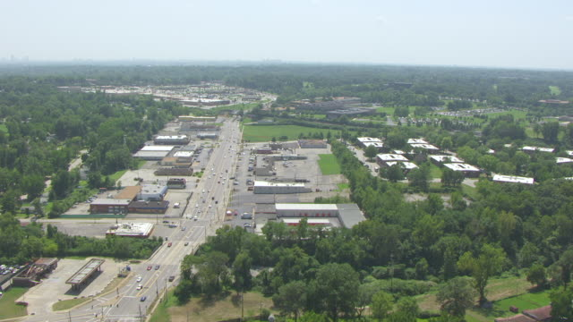WS AERIAL View of Ferguson street and businesses / St Louis, Missouri, United States