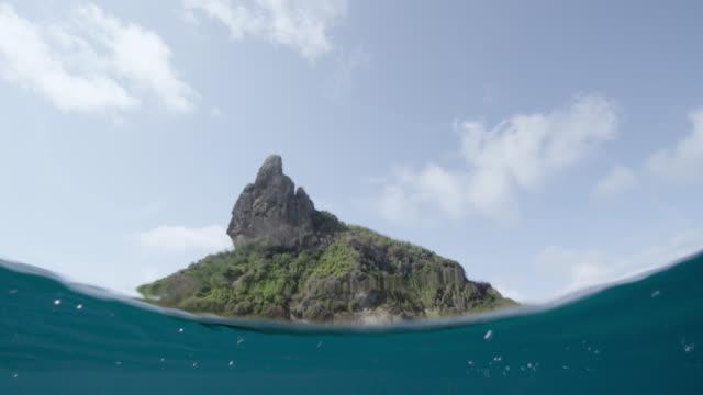 view of fernando de noronha from ocean, brazil - atlantik stock-videos und b-roll-filmmaterial