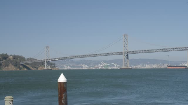 vídeos de stock e filmes b-roll de view of ferry and oakland bay bridge from pier 1, san francisco, california, united states of america, north america - san francisco oakland bay bridge