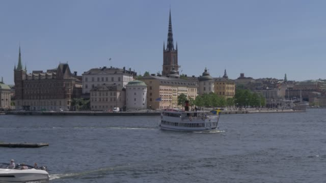 view of ferry boat and riddarholmen from town hall, stockholm, sweden, scandinavia, europe - circa 13th century stock videos & royalty-free footage