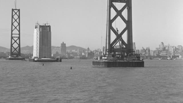 WV POV View of ferry boat in San Francisco Bay city skyline and bay bridge is under construction