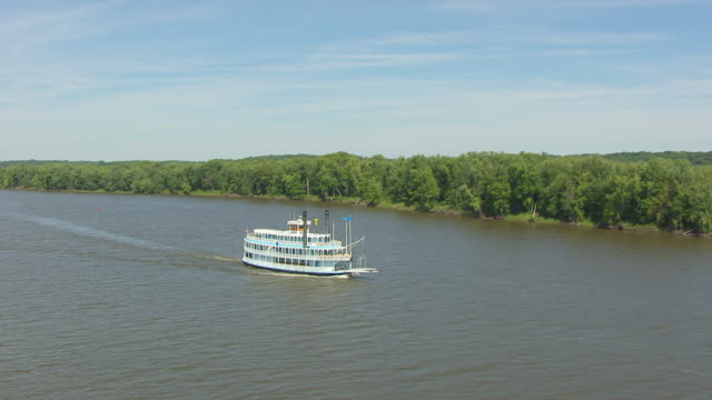 ws aerial pov view of ferry boat moving in mississippi river / jo daviess county, illinois, united states  - illinois bildbanksvideor och videomaterial från bakom kulisserna