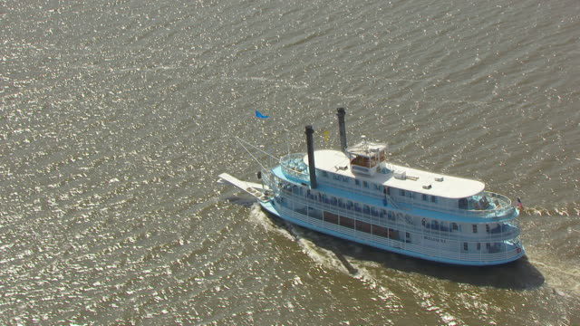 WS AERIAL TS ZO View of ferry boat moving in Mississippi River / Jo Daviess County, Illinois, United States