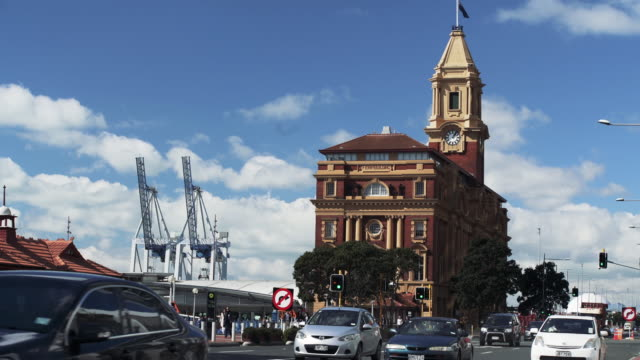 view of ferry building across the road, auckland, new zealand. - auckland ferry stock videos & royalty-free footage