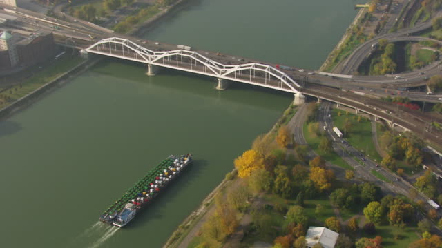 ws aerial ds view of ferry in river to university with running railway and highway / mannheim, baden wurttemberg, germany - baden wurttemberg stock videos and b-roll footage