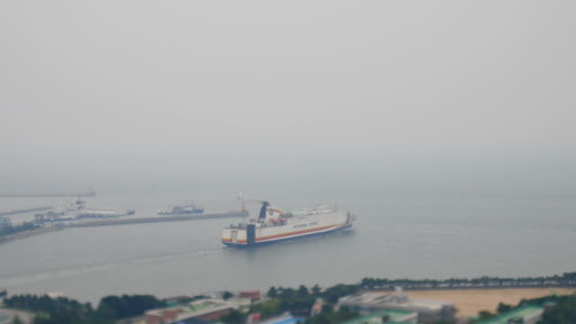 view of ferry leaving incheon harbor (famous harbor in korea) - ferry stock videos & royalty-free footage