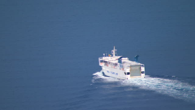 WS TS AERIAL View of ferry moving in ocean / Cyclades, Greece