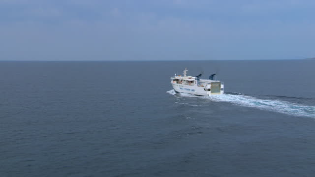 ws aerial view of ferry moving in open water / cyclades, greece - ferry stock videos & royalty-free footage