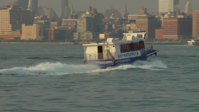 ws pan zo view of ferry on hudson river leaving to go to manhattan / new york city, new york, usa - river hudson stock videos & royalty-free footage