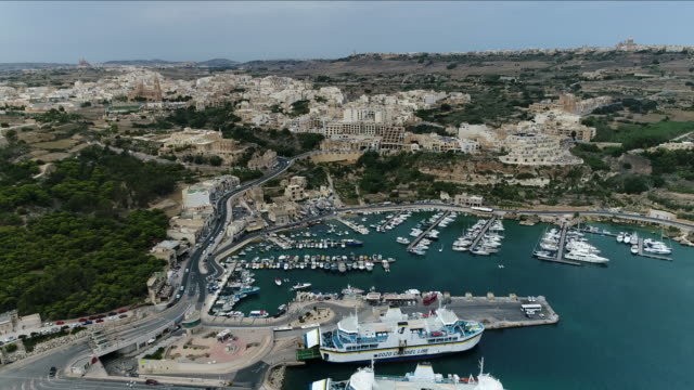 view of ferry terminal area in gozo island, malta - bay of water stock videos & royalty-free footage