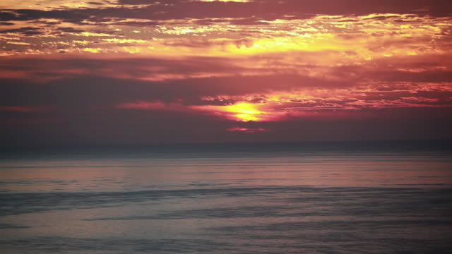 ws view of fiery sunrise sky and ocean / montezuma, costa rica - kelly mason videos stock videos & royalty-free footage