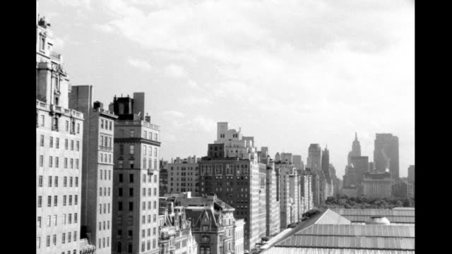 view of fifth avenue, manhattan apartment buildings on east side of street, shot from roof of metropolitan museum of art, then pan left and down,... - metropolitan museum of art new york city stock videos & royalty-free footage