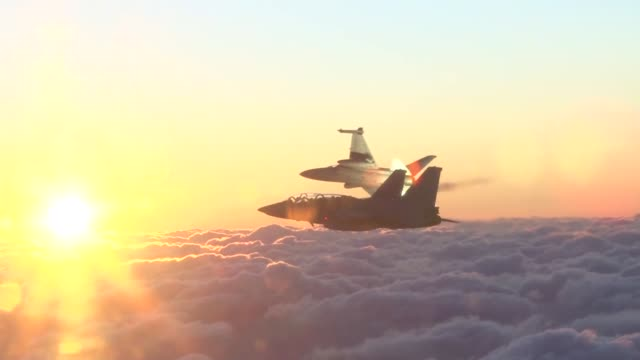 view of fighter plane firing flares over the cloud in south korea - military training stock videos & royalty-free footage