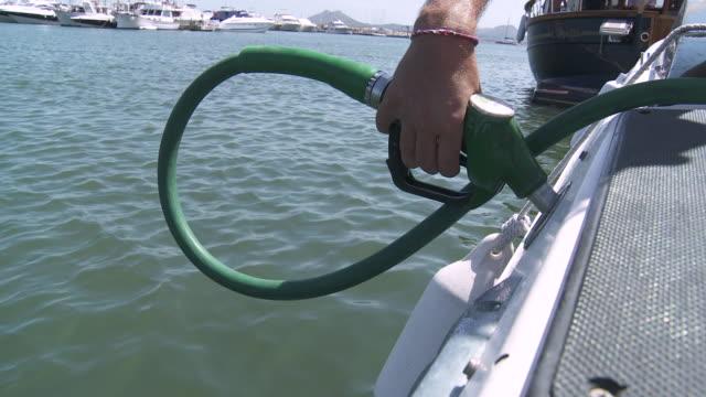 ecu view of filling thank of speedboat / palma de majorque, majorque, spain - fuel pump stock videos & royalty-free footage